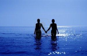 two-bikini-girls-holding-hands
